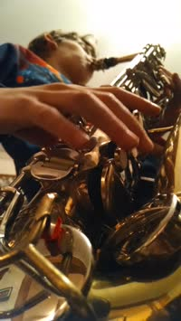 Xavier Playing the Saxophone